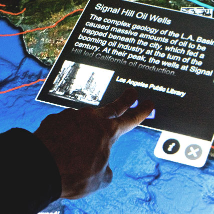 Visitors explore the geography of the Los Angeles basin in a multitouch multiuser mapping exhibit